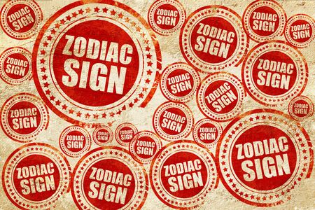 premonition: zodiac sign, red stamp on a grunge paper texture Stock Photo