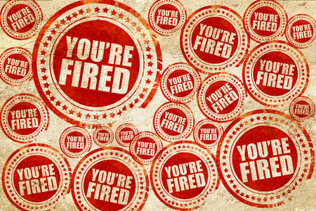 you are fired: youre fired, red stamp on a grunge paper texture Stock Photo