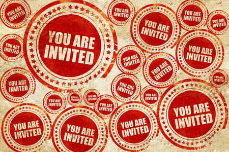 invited: you are invited, red stamp on a grunge paper texture