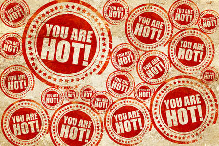 compliment: you are hot!, red stamp on a grunge paper texture