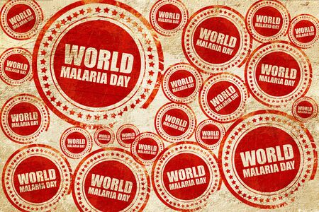 malaria: world malaria day, red stamp on a grunge paper texture