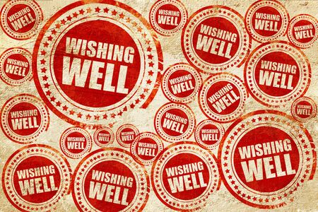 water well: wishing well, red stamp on a grunge paper texture