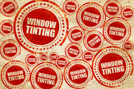 tinting: window tinting, red stamp on a grunge paper texture Stock Photo
