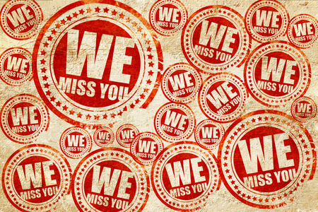 we miss you, red stamp on a grunge paper texture
