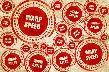 warp speed: warp speed, red stamp on a grunge paper texture Stock Photo