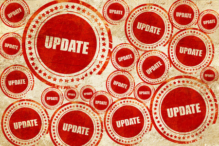 upgrading: update sign background with some soft smooth lines, red stamp on a grunge paper texture Stock Photo