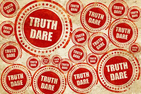dare: truth or dare, red stamp on a grunge paper texture