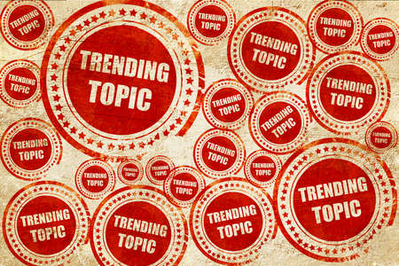topic: trending topic, red stamp on a grunge paper texture