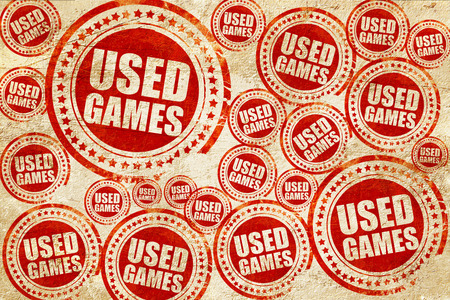 users video: used games, red stamp on a grunge paper texture Stock Photo