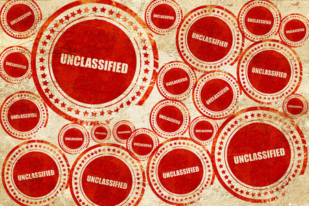 unclassified, red stamp on a grunge paper texture Stock Photo