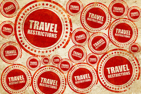 restrictions: travel restrictions, red stamp on a grunge paper texture Stock Photo
