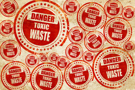 toxic waste: Toxic waste sign with some smooth lines, red stamp on a grunge paper texture Stock Photo