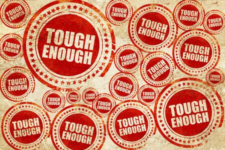 tough: tough enough, red stamp on a grunge paper texture