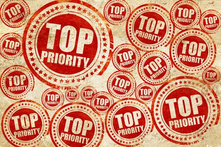 top priority, red stamp on a grunge paper texture Stock Photo