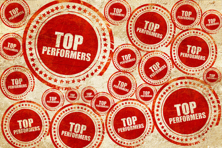 recognizing: top performers, red stamp on a grunge paper texture