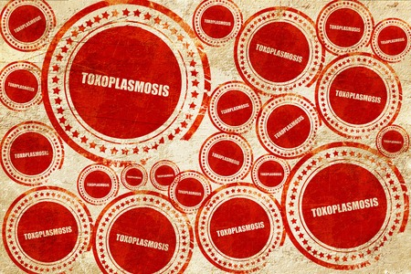 teratogenic: toxoplasmosis, red stamp on a grunge paper texture Stock Photo