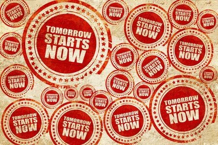 tomorrow: tomorrow starts now, red stamp on a grunge paper texture Stock Photo