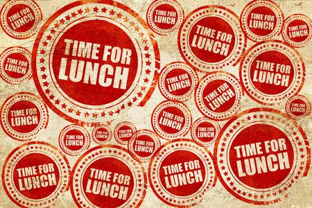 regenerate: time for lunch, red stamp on a grunge paper texture Stock Photo