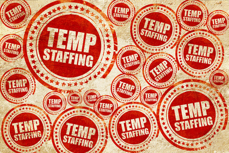 staffing: temp staffing, red stamp on a grunge paper texture