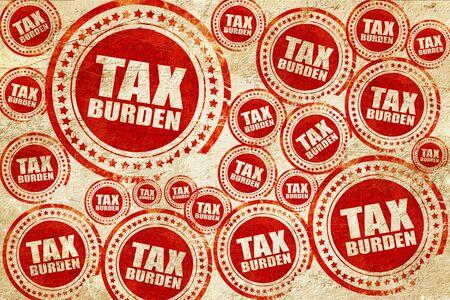 financial burden: tax burden, red stamp on a grunge paper texture