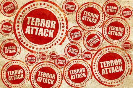 terror: terror attack, red stamp on a grunge paper texture