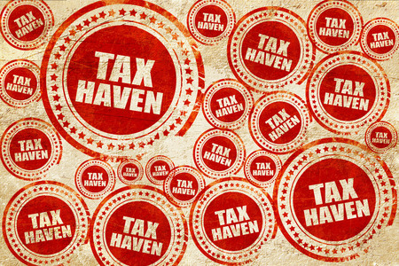 accommodation space: tax haven, red stamp on a grunge paper texture