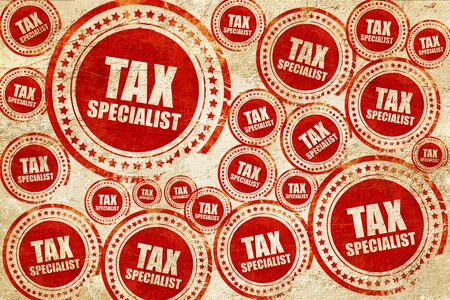 tax tips: tax specialist, red stamp on a grunge paper texture