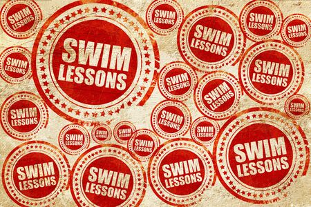 lessons: swim lessons, red stamp on a grunge paper texture