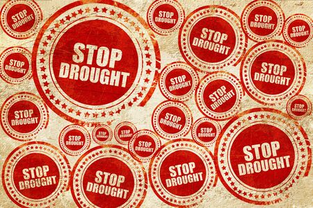 source of iron: stop drought, red stamp on a grunge paper texture Stock Photo
