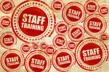 staff training: staff training, red stamp on a grunge paper texture