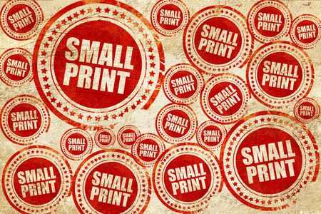 hidden fees: small print, red stamp on a grunge paper texture
