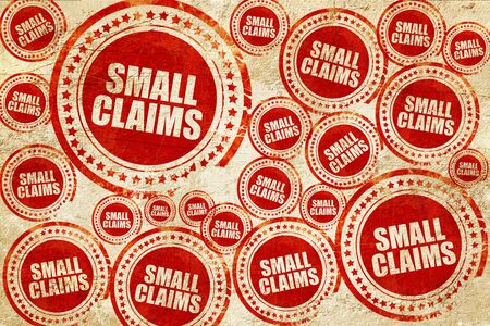 duty belt: small claims, red stamp on a grunge paper texture Stock Photo