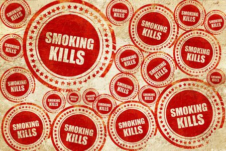 killing cancer: smoking kills, red stamp on a grunge paper texture Stock Photo