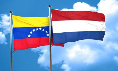 venezuela flag: bandera de Venezuela con la bandera de Pa�ses Bajos, 3D Foto de archivo