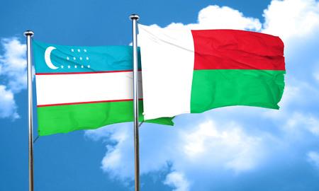 uzbekistan: Uzbekistan flag with Madagascar flag, 3D rendering Stock Photo