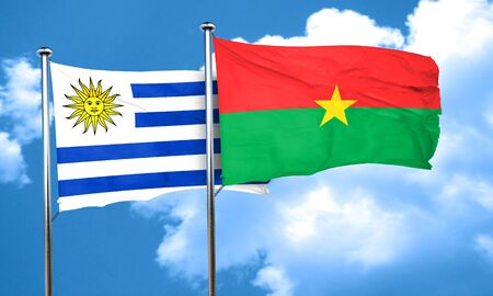uruguay flag: Uruguay flag with Burkina Faso flag, 3D rendering Foto de archivo
