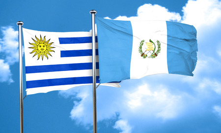 uruguay: Uruguay flag with Guatemala flag, 3D rendering Stock Photo