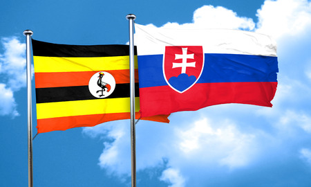 slovakia flag: Uganda flag with Slovakia flag, 3D rendering Stock Photo