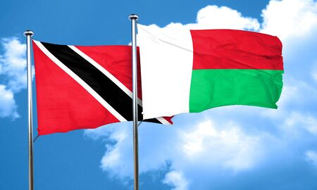 trinidad and tobago: Trinidad and tobago flag with Madagascar flag, 3D rendering Stock Photo