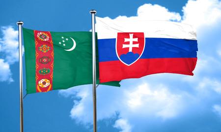 slovakia flag: Turkmenistan flag with Slovakia flag, 3D rendering Stock Photo