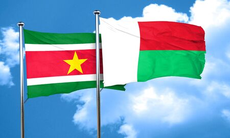suriname: Suriname flag with Madagascar flag, 3D rendering Stock Photo