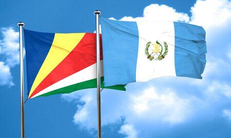 seychelles: seychelles flag with Guatemala flag, 3D rendering Stock Photo