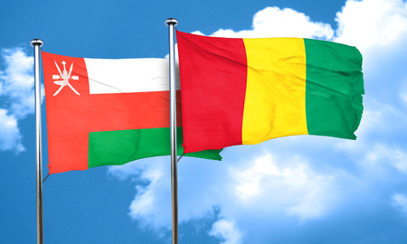 guinea: Oman flag with Guinea flag, 3D rendering
