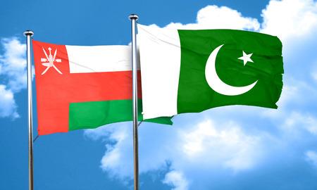 flag of pakistan: Oman flag with Pakistan flag, 3D rendering Stock Photo
