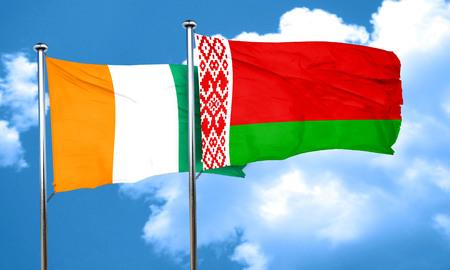 coast: Ivory coast flag with Belarus flag, 3D rendering Stock Photo
