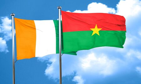 Ivory coast flag with Burkina Faso flag, 3D rendering Banco de Imagens