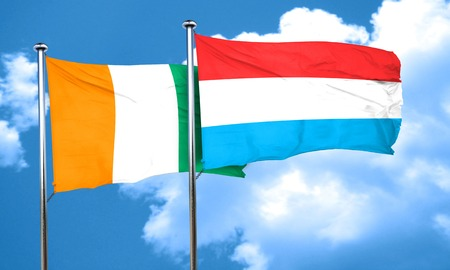 coast: Ivory coast flag with Luxembourg flag, 3D rendering