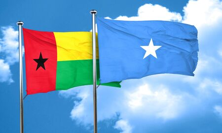 somalian culture: Guinea bissau flag with Somalia flag, 3D rendering Stock Photo
