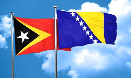 bosnia and  herzegovina: east timor flag with Bosnia and Herzegovina flag, 3D rendering