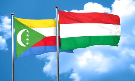 comoros: Comoros flag with Hungary flag, 3D rendering